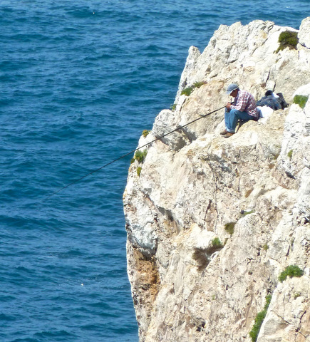 Clifftop fisherman
